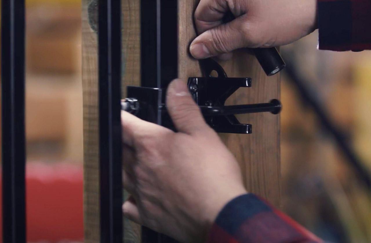 Installing a Metal Gate Between Wooden Posts